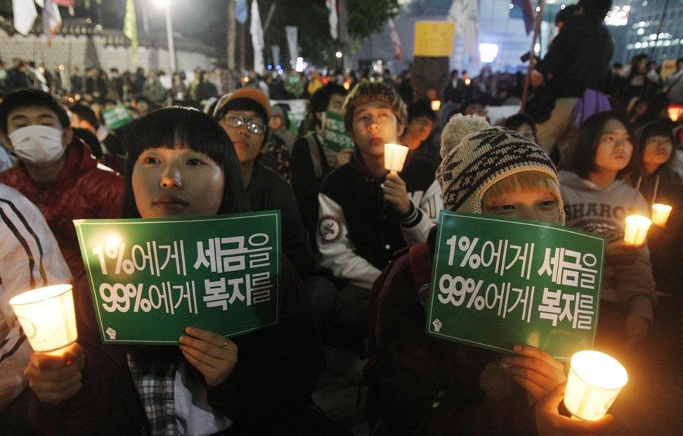 Foto de la manifestación del 15-0 desde Seúl. Los países asiáticos han sido los primeros en sumarse a las movilizaciones globales.-