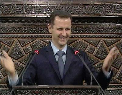 Imagen de la televisión libia que muestra al presidente sirio Bachar al Asad durante su intervención en el Parlamento. - REUTERS
