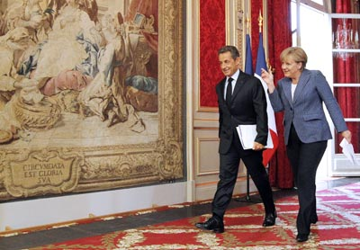 Angela Merkel y Nicolas Sarkozy, ayer tras su encuentro. -
