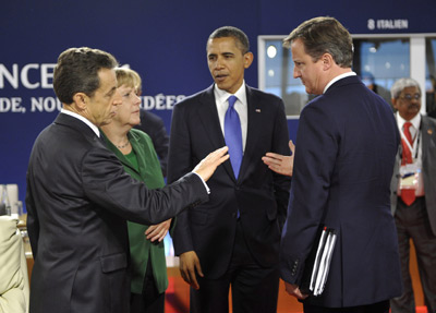 Sarkozy, Merkel, Obama and Cameron, before the G-20 in Cannes, in December 2011 .-