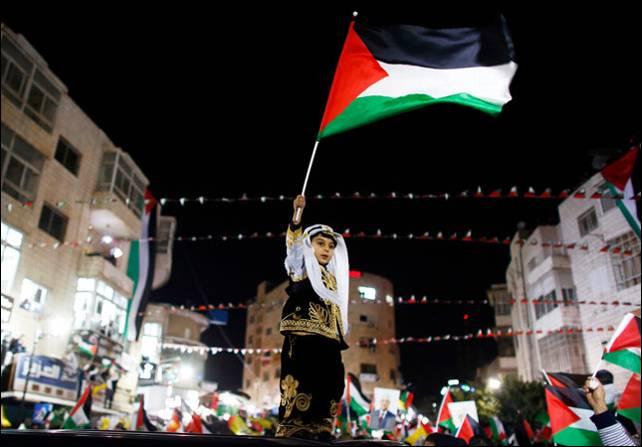 La plaza Yaser Arafat de Ramala celebró con esperanza las noticias que llegaban de Nueva York. Reuters