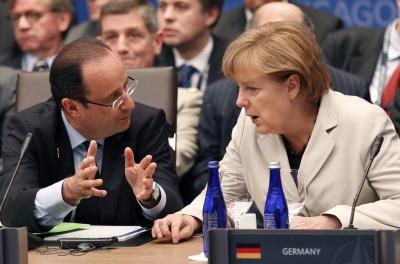 François Hollande y Angela Merkel han mantenido una conversación telefónica este sábado.-EFE