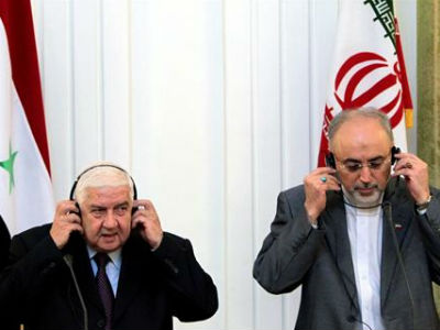El ministro sirio de Exteriores, Walid Moualem (izquierda), ha viajado a Teherán para reunirse con su homólogo iraní, Ali Akbar Salehi.