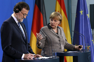 Rajoy y Merkel, durante su comparecencia.- TOBIAS SCHWARTZ (REUTERS)