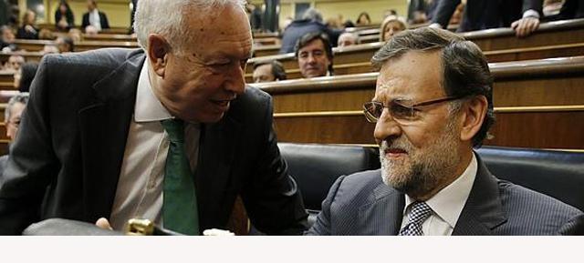 Foto de archivo del ministro de Asuntos Exteriores, José Manuel García-Margallo, y Mariano Rajoy. REUTERS