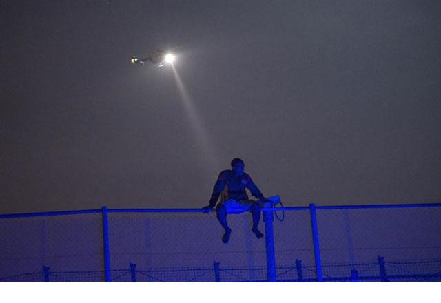 Prodein denuncia la violencia policial contra los migrantes en la valla de Melilla. REUTERS